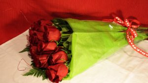 1 DOZ RED ROSES WRAPPED $36.00